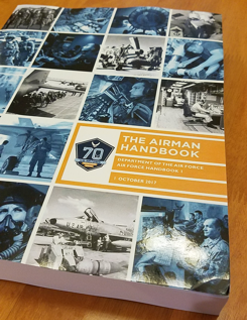 Air Force Handbook 1 on desk